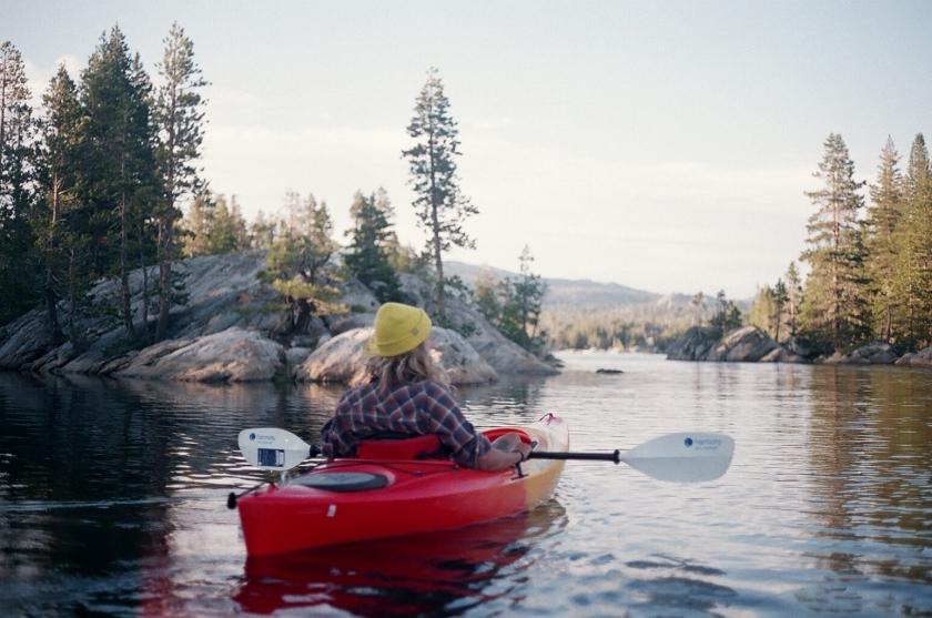 Cramped Up Utica Reservoir red kayak yellow hat