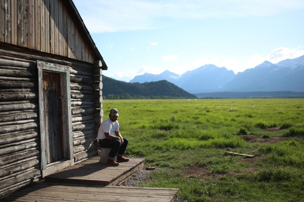 cramped up road trip grand tetons mountain log cabin